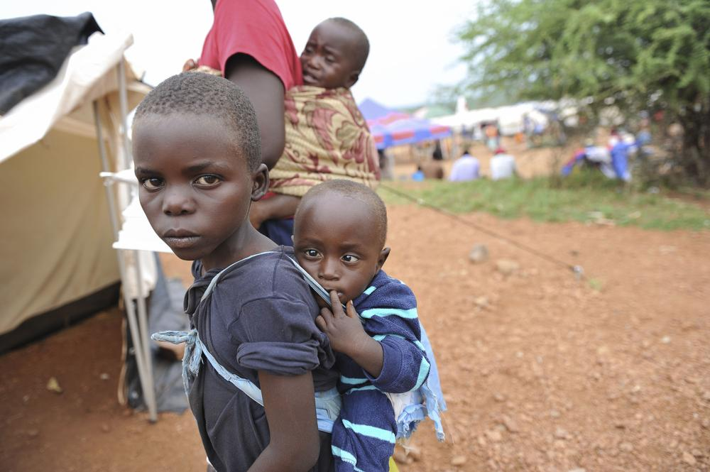 <p>Children wait for treatment outside Chingwizi camp(***)s only medical clinic, a makeshift hospital serving more than 20,000 people. </p>
