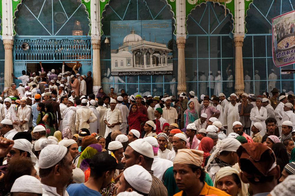 Thousands of pilgrims prepare to leave the Sufi shrine after offering prayers during the annual Urs festival.
