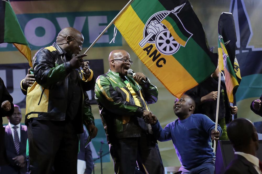 <p>President Jacob Zuma, center, sings at a victory party in Johannesburg, South Africa, after his ruling party African National Congress was declared as the electoral winner.</p>
