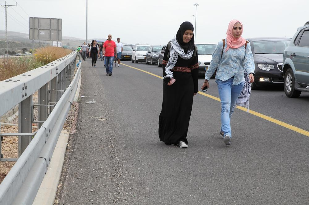 <p>With Israeli roads at a standstill under the weight of Independence Day traffic, many Palestinian activists disembarked from their buses and walked the last few kilometres to reach Lubya.</p>