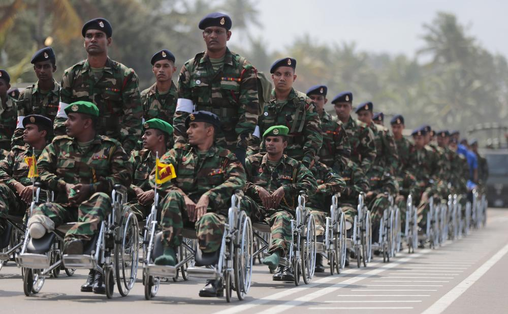 <p>Sri Lankan veterans participate in a Victory Day parade in Matara, about 150kms south of the capital, Colombo. Sri Lanka(***)s government marked the fifth anniversary of its victory in a civil war over ethnic Tamil separatists.</p>