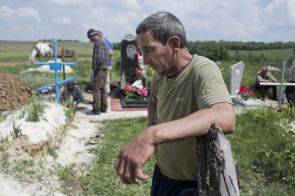 <p>Aleksander Ott, Lena's husband, stood by as friends from the village of Starovarvarivka dug a grave for his wife. Wavering between silence and bouts of breathless anger, he accused the Ukrainian army of the killing.</p>