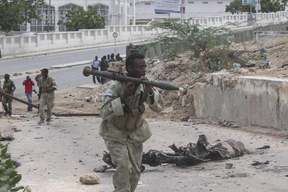 <p>A Somali soldier walks past debris after a car bomb exploded in front of the parliament building in Mogadishu. Al-Shabab claimed responsibility for the attack. According to police, at least four people were killed in the two blasts.</p>