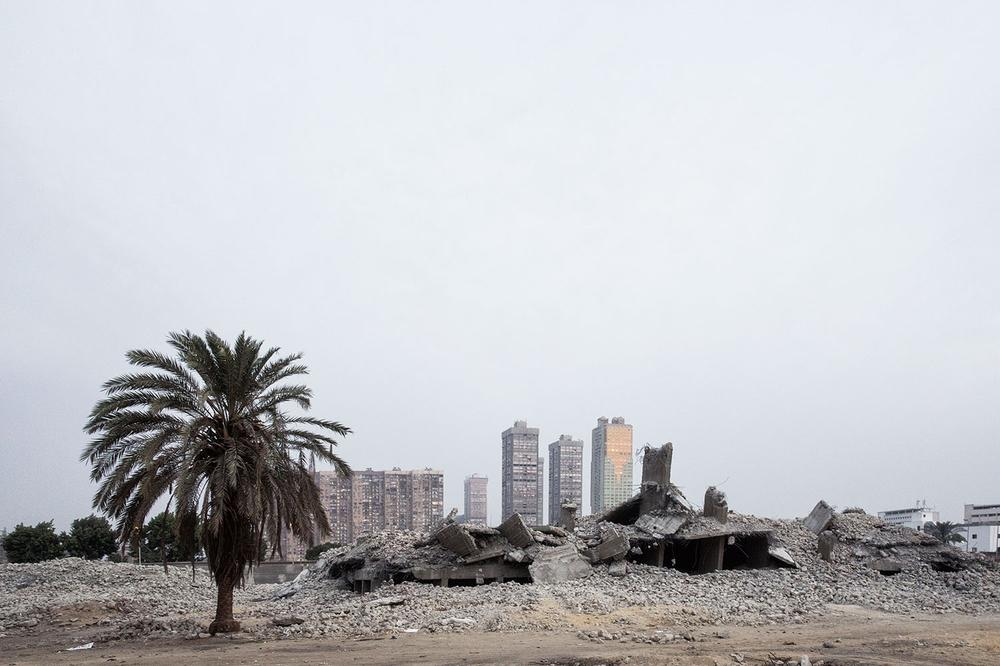 In the front lays the debris of downed buildings, former residences of Egyptian families who bought the land decades ago and are still in the possession of the purchase deed. They are now ordered to leave the site, as this will be used for military purposes.