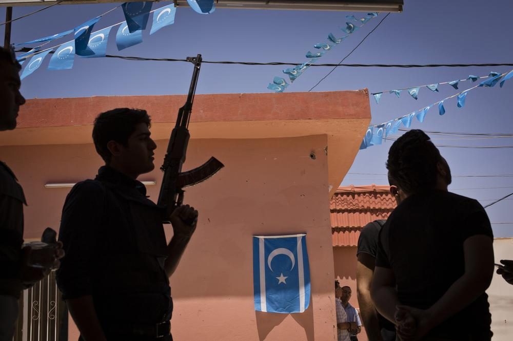 Turkmen militiamen gather at the headquarters of the Iraqi Turkmen Front (ITF) in Kirkuk. The head of the ITF, Arshad Salihi, announced the mobilisation of Turkmen militia in response to the ongoing crisis in Iraq.