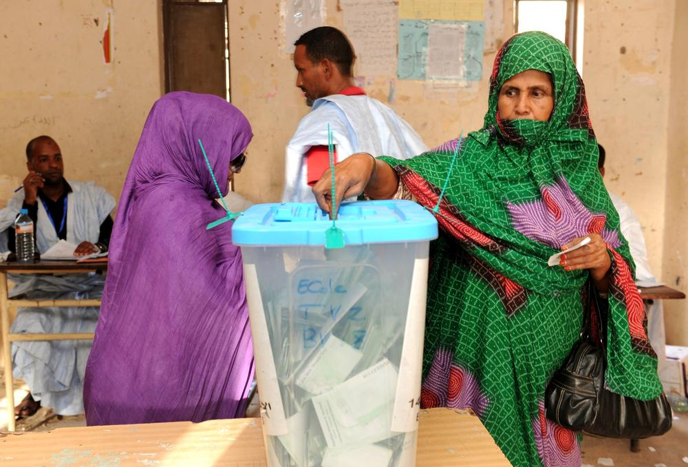 <p>A Mauritanian casts her ballot at a polling station in Nouakchott during the presidential elections. President Mohamed Ould Abdel Aziz, an ex-general who led a coup in 2008, is expected to win Saturday(***)s presidential election amid an opposition boycott.</p>