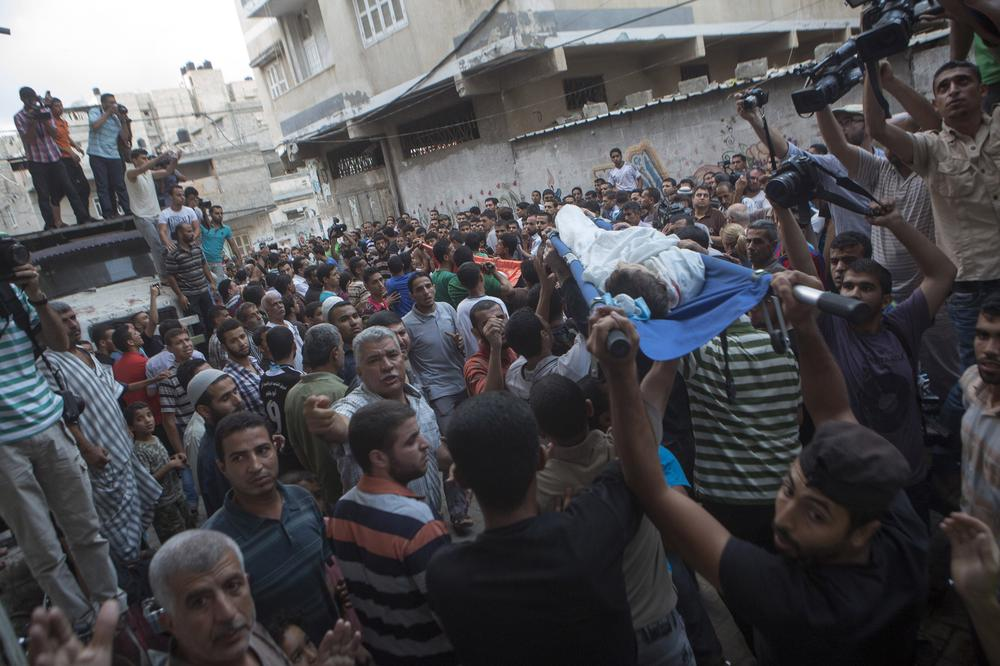 Palestinian mourners carry the bodies of the three children from the Shuhaibar family, killed in an Israeli airstrike in the Sabra neighbourhood of Gaza City on Thursday.
