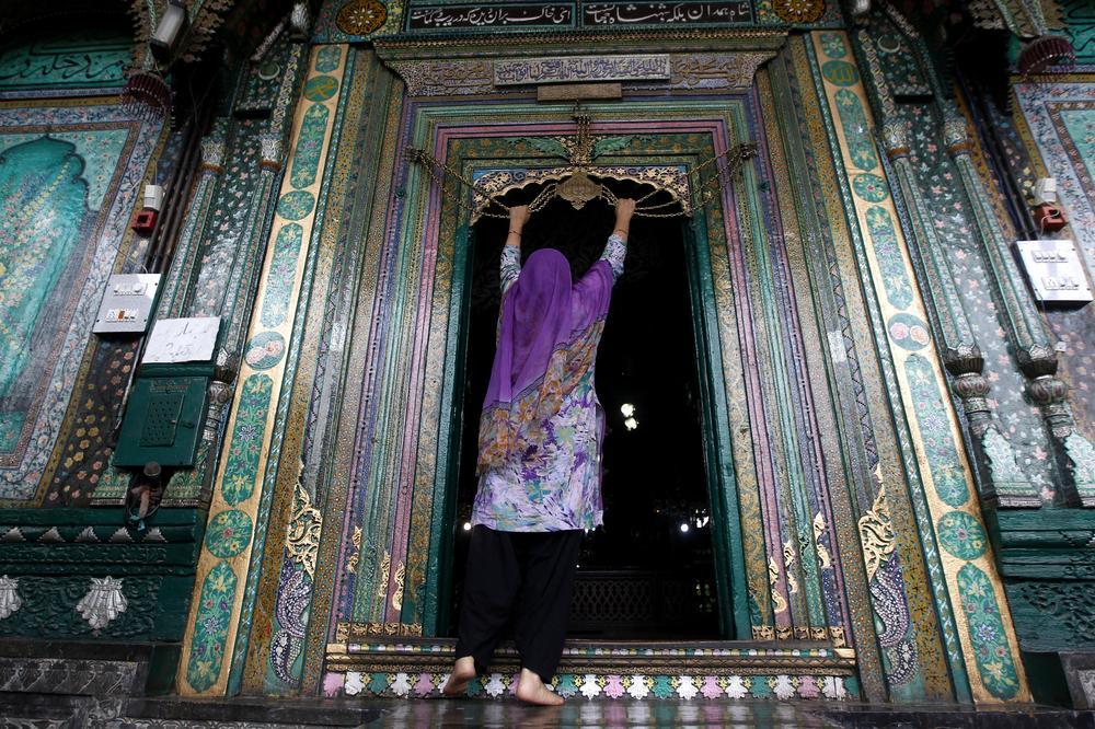 A Kashmiri Muslim woman at the entrance of the shrine of Mir Syed Ali Hamdani - a Sufi saint, also known as Shah-e-Hamadan or King of Hamadan, Iran - who travelled to Kashmir from Iran in 1372 to spread Islam in the region.