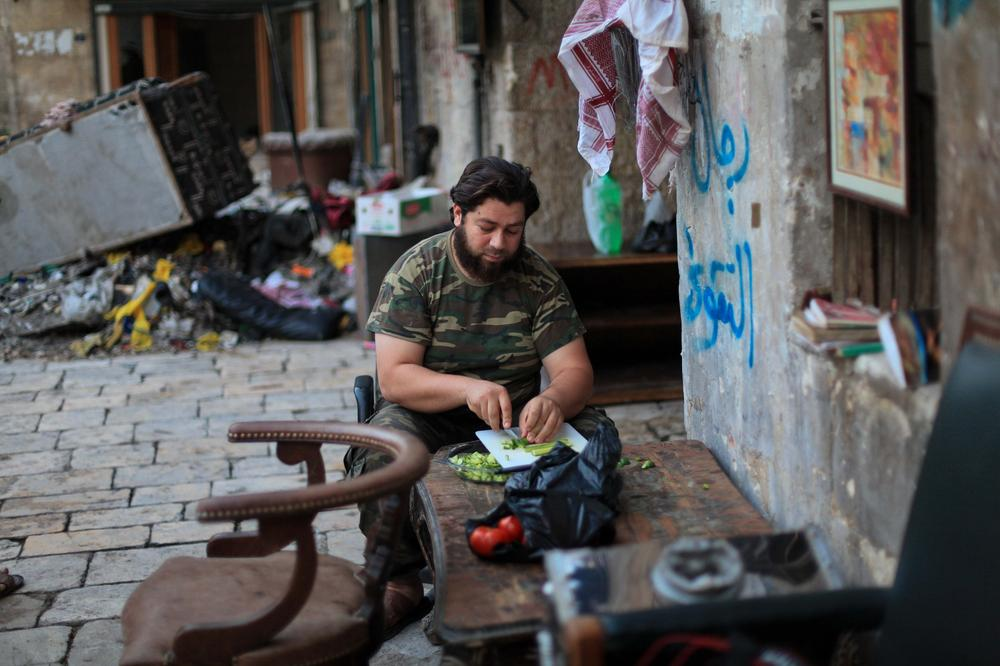 A Free Syrian Army fighter prepares food to break his daily fast during the Islamic holy month of Ramadan.