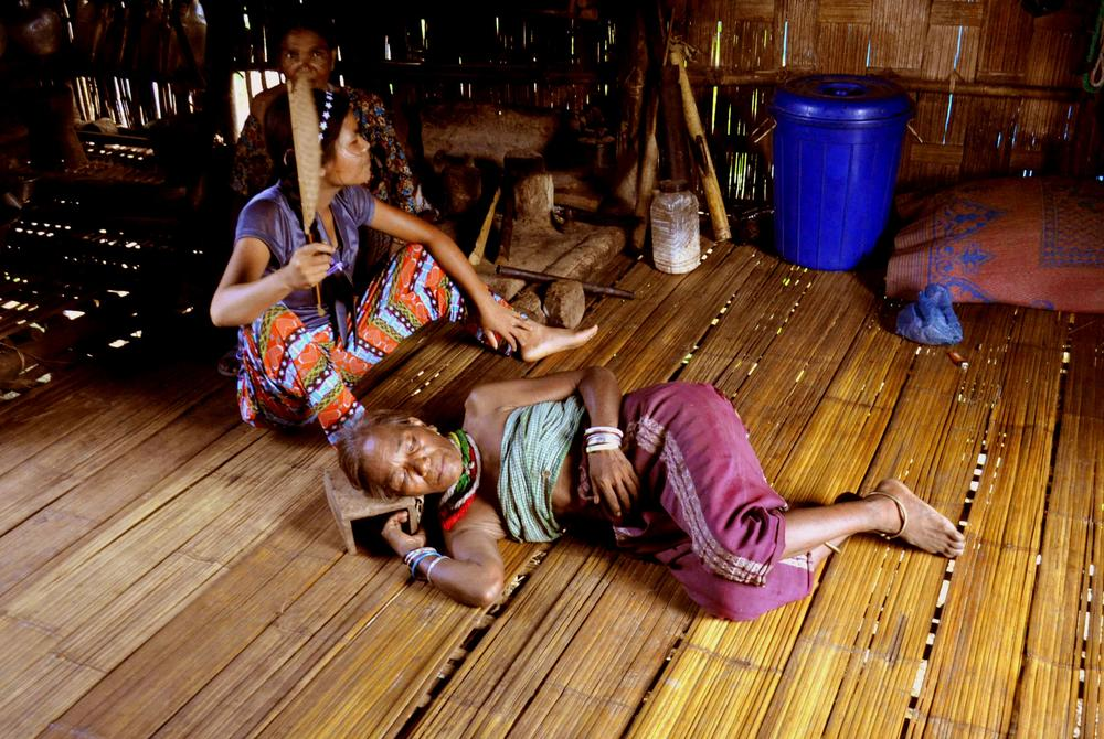 <p>A Bru (locally called Reang) woman diagnosed with malaria lies on the floor of her bamboo hut as her daughter fans her in the Ashapara camp in Kanchanpur in North Tripura district, 230km northeast of Agartala, the capital of Tripura state.</p>