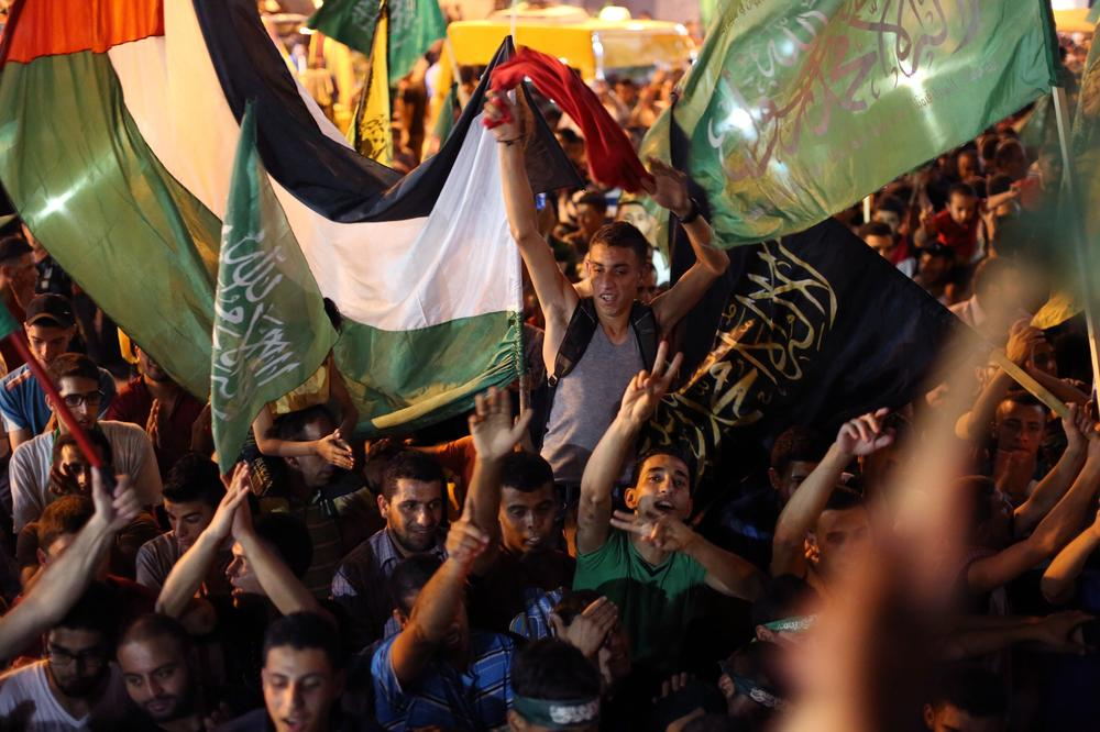 Thousands of Palestinians celebrated in Gaza after Israel and Palestinian groups agreed to an open-ended ceasefire to end seven weeks of fighting in Gaza.