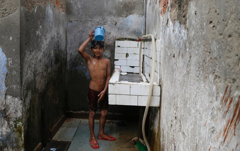 """Every day after school, I come to take a shower in this private bathroom for five rupees ($0.08), because there is no water at my home. We buy water for drinking but can(***)t afford it for other purposes,"" says Mohmmad Ansari, 12, of the Sanjay colony neighbourhood in South Delhi."