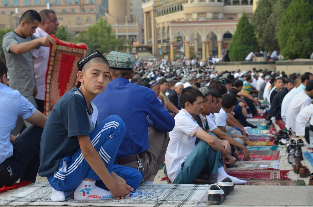 As the imam(***)s sermon booms from the mosque loudspeakers, thousands of Uyghurs congregate in the square. Each brings with him his own prayer carpet.