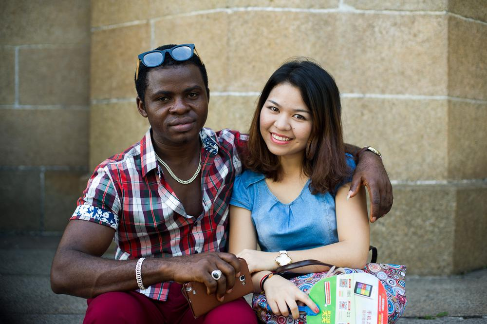 (***)Fine(***), a Nigerian who declined to give his last name and his Chinese girlfriend pose outside the Sacred Heart of Jesus Cathedral. Some African migrants are able to operate businesses through Chinese partners, although permanent residency is almost impossible to acquire.