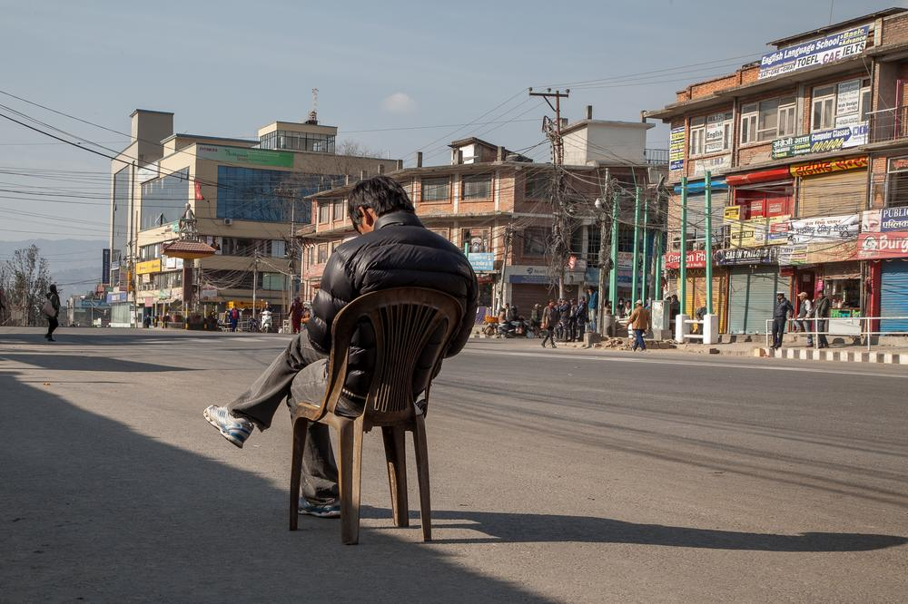 A man sits in the middle of Kathmandu's ring road during the opposition bandh that shut down the city.