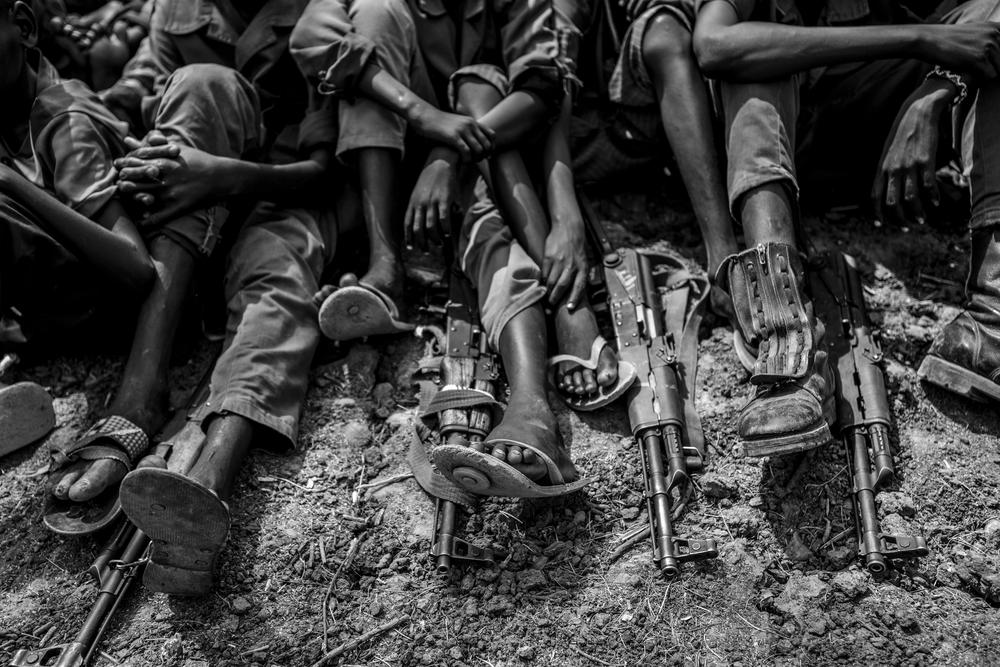 Child soldiers from the Cobra faction gather to be taken into the care of UNICEF in Pibou, South Sudan.