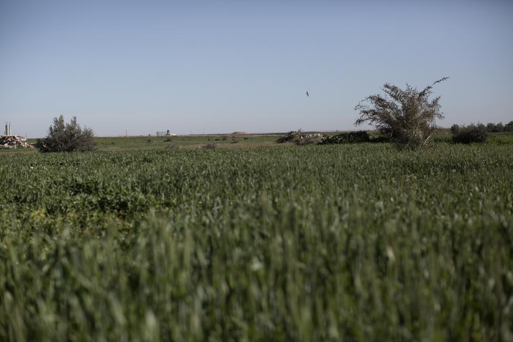 An Israeli drone prepares to land near a military outpost on the outskirts of Faraheen, near the city of Khan Younis in the southern Gaza Strip.