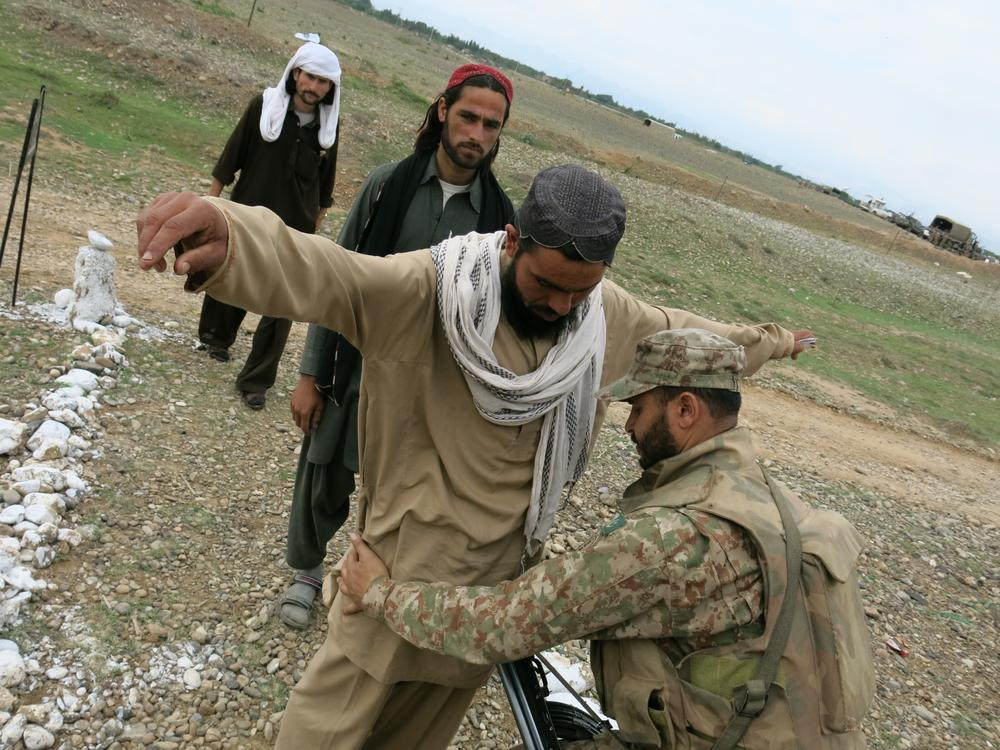 Those arriving at the voluntary repatriation camp are patted down by army soldiers who  control of the camp. The Tehreek-e-Taliban Pakistan (TTP) has made threats to those who want to return to their areas, saying they will be targeted for colluding with the Pakistani state.