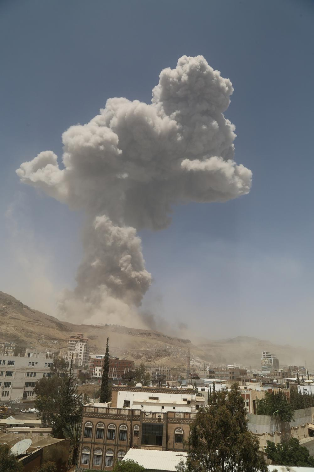 A large cloud of smoke resulting from an air strike on the Faj Attan base is seen from about 5km away.