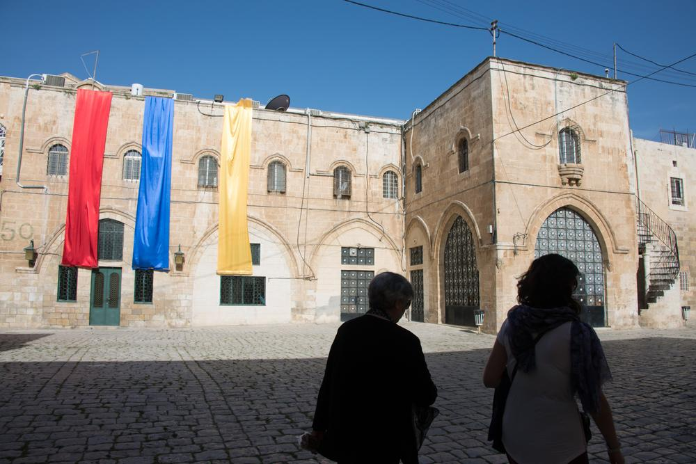 The convent that surrounds St James Cathedral remains off-limits to visitors without a local guide. Here, the colours of the Armenian flag hang overhead as members of the Armenian community cross the convent courtyard.