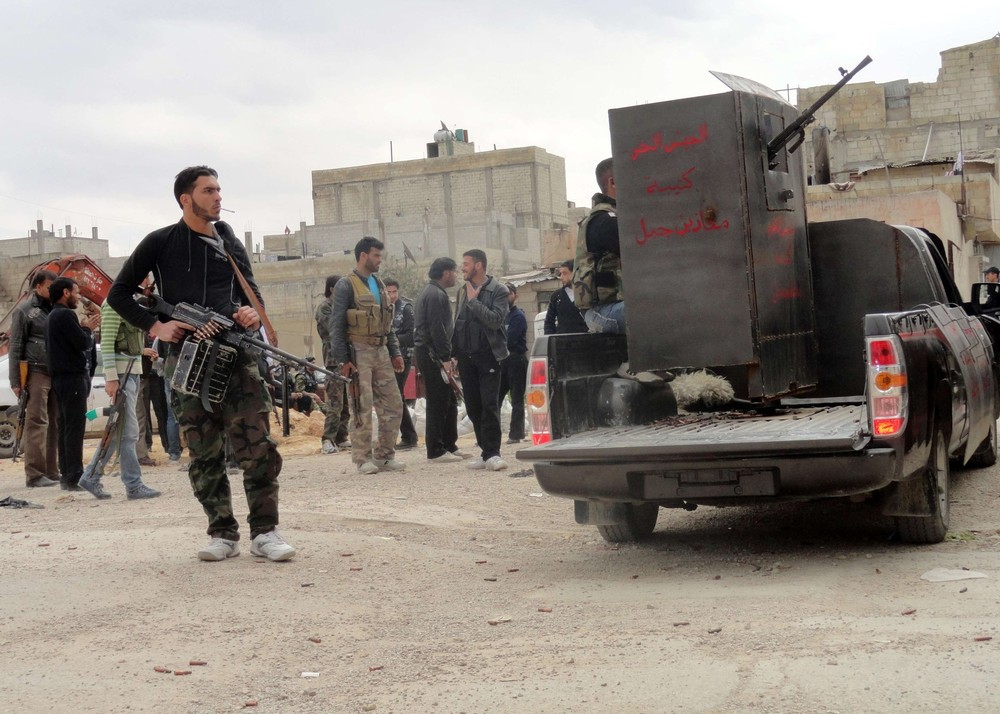 Syrian troops launched a ground attack in Homs on Wednesday in an apparent attempt to overrun the rebel-held Baba Amro neighbourhood. Above, members of the Free Syrian Army are seen deployed in al-Bayada, Homs.