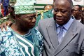 President Gbagbo (R) is accused of undermining French-backed peace deal