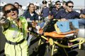 Rescuers in Palermo bring in survivors of the plane crash