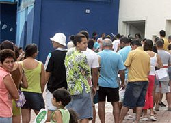 Brazilians line up to vote at the national poll on gun control