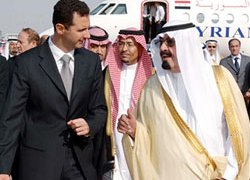 King Abdullah (R) met al-Assad in Jedda on Sunday