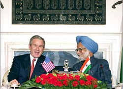 Bush and Singh (R) signed the nuclear deal in March