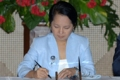 President Gloria Macapagal Arroyo signs the law on Saturday