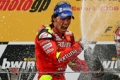 Spaniard Toni Elias celebrates his maiden MotoGP victory