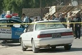 Armed men drove up to the higher education ministry in Baghdad in government vehicles