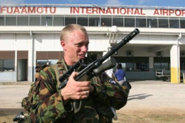 A New Zealand soldier patrols Fua'amotu airport