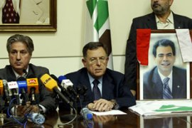 Former Lebanese president Amin Gemayel (L) appealed for calm after his son's assassination