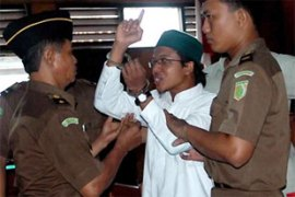 Wibowo, centre, said he got the gun while fighting Christians in Ambon, the capital of Maluku province