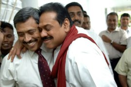 Gotabaya Rajapakse, left,  went to see his brother, President Mahinda Rajapakse, after the attack