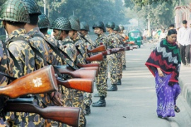 Bangladeshi security forces stand guard during a nationwide transport blockade