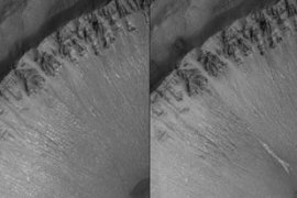 The image on the right shows a gully in a crater formed after the photo on the left was taken in 1999