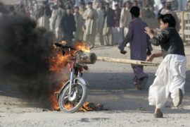 Protesters burnt police vehicles during the strike in Karachi