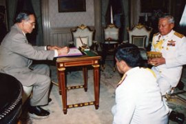 Thailand's king signed a temporary constitution after the September 19 coup