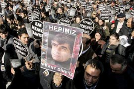 "Mourners held identical black-and-white signs reading ""We are all Hrant Dink"" [AP]"