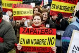Protesters bore placards asking Zapatero to refrain from negotiating with Eta [AFP]