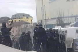 Police held at least 20 people throwing stones and bottles at Saturday's protest in Pristina [Al Jazeera]