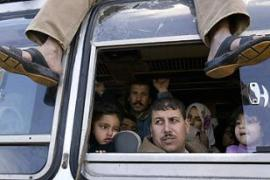 Palestinians wait inside a bus, some are returning tothe Rafah crossing for a fifth time [Reuters]