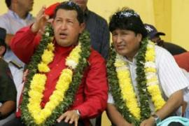 Chavez, left, accused the US of plotting to kill him and Evo Morales, Bolivia's president [AFP]