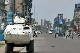UN armoured personnel carriers patrolled the streets of Kinshasha to protect civilians