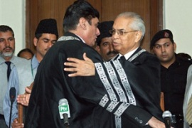 Rana Bhagwandas, right, before he took the oath as Pakistan'sacting chief justice [AFP]