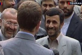 "One of the navy personnel told Ahmadinejad, right, that he was ""grateful for your forgiveness"" [Reuters]"