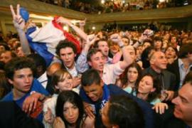 Sarkozy's victory set off jubilant scenes among supporters gathered in central Paris. [AFP]